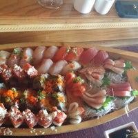 Photo taken at Land of Sushi by Sandra B. on 12/14/2013