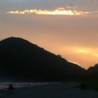 Photo taken at Praia Itamambuca by Pri M. on 2/24/2013