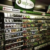 Photo taken at GameStop by David B. on 3/2/2013