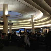Photo taken at Terminal 5 by Mikhail M. on 1/19/2013