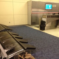 Photo taken at Gate A29 by Bethany C. on 7/29/2014