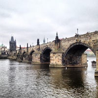 Photo taken at Charles Bridge by Mikhail S. on 5/2/2013