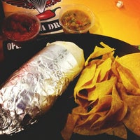 Photo taken at Flaming Amy's Burrito Barn by Carly W. on 3/13/2013