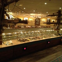 Photo taken at Captain George's Seafood Buffet by Sara G. on 5/3/2013