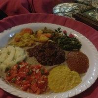 Photo taken at Meskerem Ethiopian Restaurant by Vivi X. on 7/27/2013