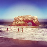 Photo taken at Natural Bridges State Beach by muse b. on 7/15/2013