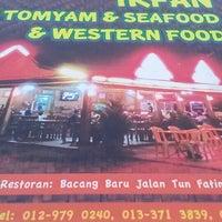 Photo taken at Irfan Tomyam Seafood by Musri G. on 7/6/2014