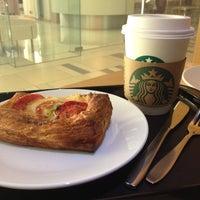 Photo taken at Starbucks by にゃりんこ こ. on 7/14/2013