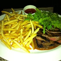 Photo taken at Wolfgang Puck Bar & Grill by pb on 8/24/2011