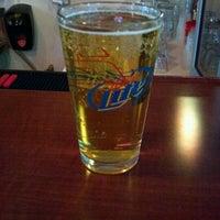 Photo taken at Muddy River Bar & Grill by chopperlasvegas on 12/15/2011