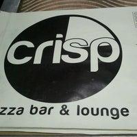 Photo taken at CRISP Pizza Bar & Lounge by Chris S. on 9/5/2011