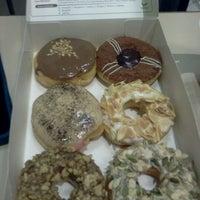 Photo taken at Big Apple Donuts & Coffee by Fadzli K. on 9/27/2011