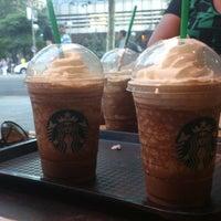 Photo taken at Starbucks Coffee by Julio S. on 8/4/2012