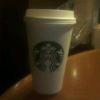 Photo taken at Starbucks by Nina on 4/3/2012