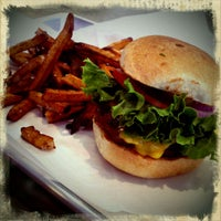 Photo taken at Fat Cow Burgers and Salads by Kelly S. on 8/16/2011