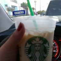 Photo taken at Starbucks by Mayra V. on 5/31/2012