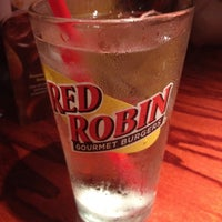 Photo taken at Red Robin Gourmet Burgers by Raine on 6/21/2012
