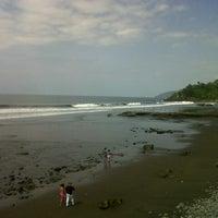 Photo taken at Playa El Zonte by Carlos on 9/30/2012