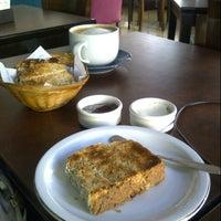 Photo taken at Origen Cafe by Anita M. on 1/13/2013