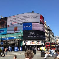 Photo taken at Piccadilly Circus by Richard B. on 7/19/2013