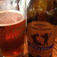 Photo taken at The Wing Cafe and Tap House by Matthew W. on 7/27/2013