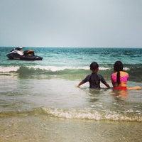 Photo taken at Pantai Teluk Kemang by Artid J. on 7/21/2013