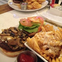 Photo taken at The Over/Under Bar & Grill by Danielle T. on 3/20/2013