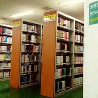 Photo taken at 국민대학교 성곡도서관 by Riris H. on 4/2/2013