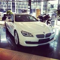 Photo taken at BMW АВТОDOM by Dmitriy S. on 9/15/2013