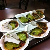 Photo taken at Tacos El Poblano by Ellene O. on 10/7/2012