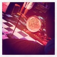 Photo taken at News Cafe by Kayla A. on 6/16/2012