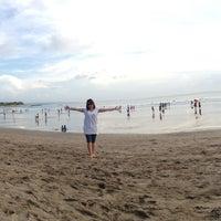 Photo taken at Pantai Kuta (Kuta Beach) by Conny I. on 6/10/2013