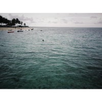 Photo taken at Derawan Beach Cafe & Cottage by Giffy D. on 9/2/2013