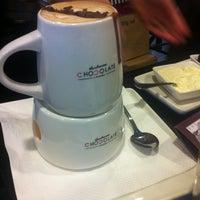 Photo taken at Theobroma Chocolate Lounge by Amanda-Lyn on 6/23/2013