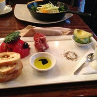 Photo taken at Medina Café by Iris on 2/9/2013