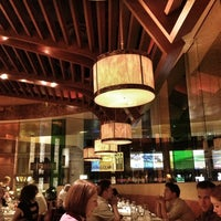 Photo taken at Mesa Grill by Brad Y. on 7/7/2013
