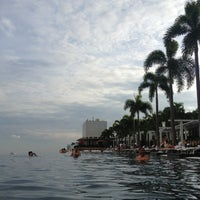 Photo taken at Rooftop Infinity Pool by mike c. on 9/3/2013
