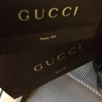 Photo taken at Gucci by Reginald H. on 11/10/2013
