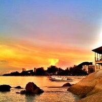 Photo taken at Batu Ferringhi Beach by Issay H. on 4/28/2013