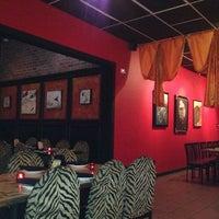 Photo taken at Babaloo International Cafe and Bar by David on 3/21/2014