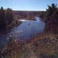 Photo taken at Au Sable River by Emma B. on 10/12/2013