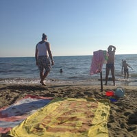 Photo taken at Lido Beach Spiaggia Libera Lido Di Camaiore by Valeria B. on 8/17/2013