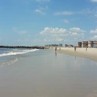 Photo taken at Rockaway Beach by Katie F. on 8/19/2016