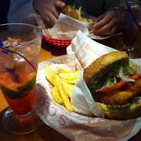 Photo taken at Red Robin Gourmet Burgers by Michelle F. on 6/9/2013