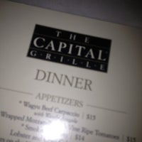 Photo taken at The Capital Grille by Sandra E. on 12/9/2012