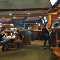 Photo taken at Smokey Bones Bar & Fire Grill by Tom T. on 6/1/2013