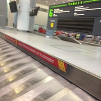 Photo taken at Baggage Claim by Manuel M. on 7/4/2013