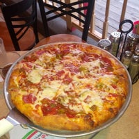 Photo taken at Grotto Pizza by Rick S. on 8/26/2013