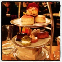 Photo taken at The Wolseley by Tina J. on 1/6/2013