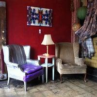 Photo taken at UnUrban Coffee House by Johnnie W. on 7/28/2013